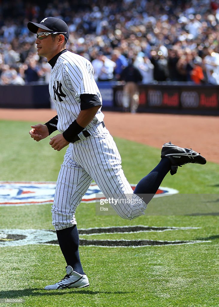 <a gi-track='captionPersonalityLinkClicked' href=/galleries/search?phrase=Ichiro+Suzuki&family=editorial&specificpeople=201556 ng-click='$event.stopPropagation()'>Ichiro Suzuki</a> #31 of the New York Yankees heads onto the field during player introductions before the game against the Boston Red Sox during Opening Day on April 1, 2013 at Yankee Stadium in the Bronx borough of New York City.