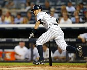 Ichiro Suzuki of the New York Yankees hits a double against the Houston Astros during the second inning in a MLB baseball game at Yankee Stadium on...