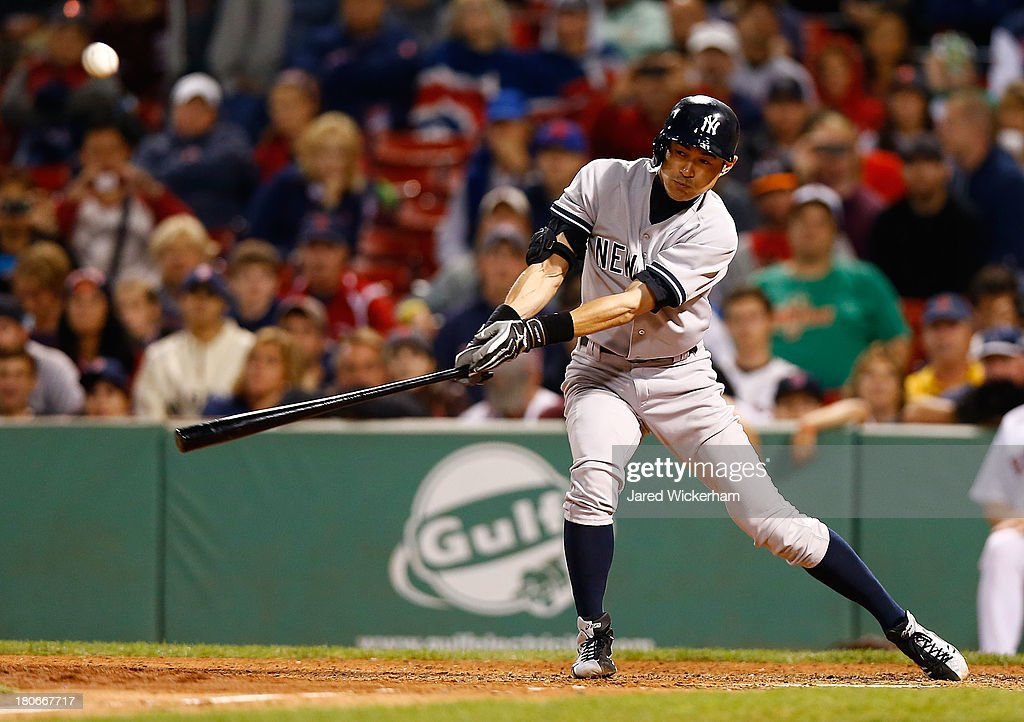 Ichiro Suzuki #31 of the New York Yankees hits a single in the 9th inning against the Boston Red Sox during the game on September 15, 2013 at Fenway Park in Boston, Massachusetts.
