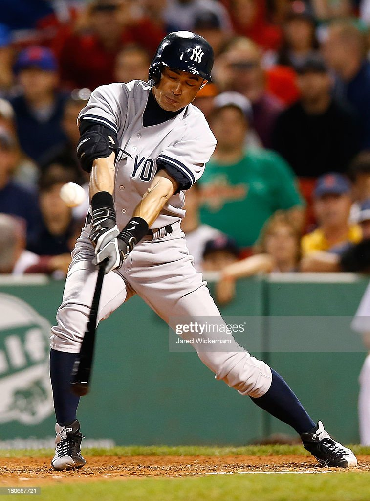 <a gi-track='captionPersonalityLinkClicked' href=/galleries/search?phrase=Ichiro+Suzuki&family=editorial&specificpeople=201556 ng-click='$event.stopPropagation()'>Ichiro Suzuki</a> #31 of the New York Yankees hits a single in the 9th inning against the Boston Red Sox during the game on September 15, 2013 at Fenway Park in Boston, Massachusetts.