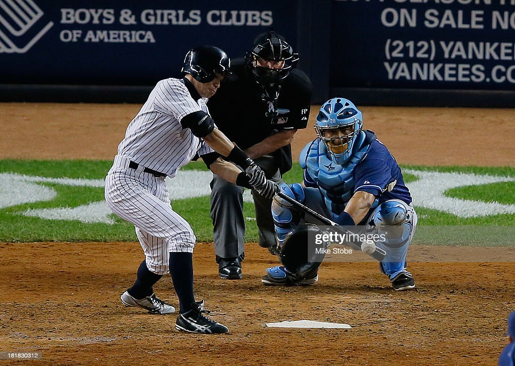 Ichiro Suzuki #31 of the New York Yankees hits a single in the eighth inning against the Tampa Bay Rays at Yankee Stadium on September 25, 2013 in the Bronx borough of New York City. Rays defeated the Yankees 8-3.