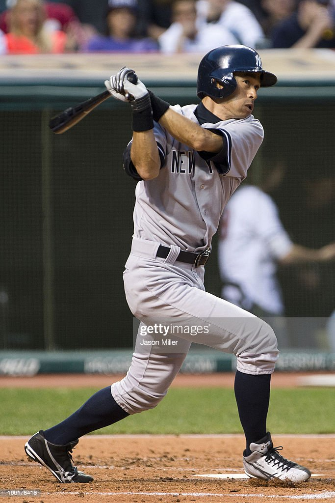 <a gi-track='captionPersonalityLinkClicked' href=/galleries/search?phrase=Ichiro+Suzuki&family=editorial&specificpeople=201556 ng-click='$event.stopPropagation()'>Ichiro Suzuki</a> #31 of the New York Yankees hits a solo home run during the third inning against the Cleveland Indians at Progressive Field on April 9, 2013 in Cleveland, Ohio.