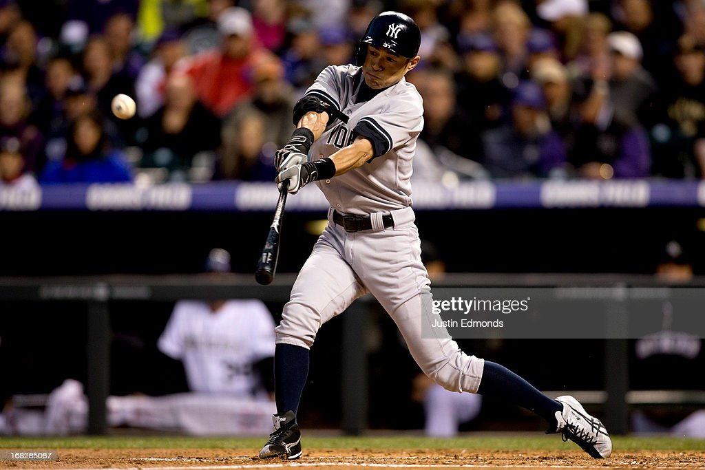 Ichiro Suzuki #31 of the New York Yankees hits a two-out single during the third inning against the Colorado Rockies at Coors Field on May 7, 2013 in Denver, Colorado.