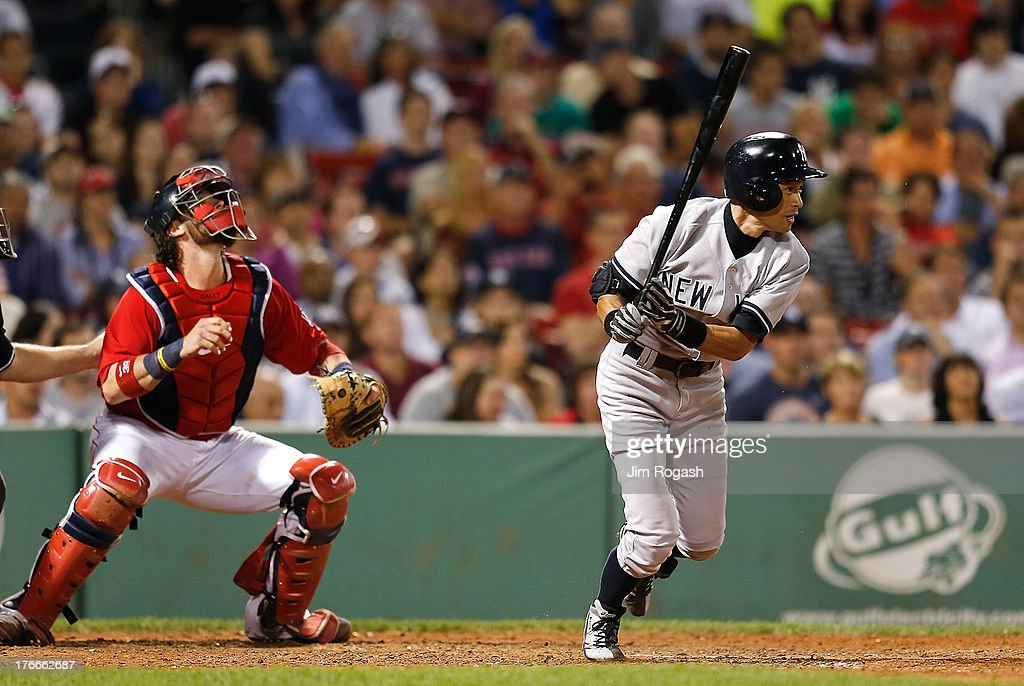 <a gi-track='captionPersonalityLinkClicked' href=/galleries/search?phrase=Ichiro+Suzuki&family=editorial&specificpeople=201556 ng-click='$event.stopPropagation()'>Ichiro Suzuki</a> #31 of the New York Yankees hits an infield single against the Boston Red Sox in the 9th innin at Fenway Park on August 16, 2013 in Boston, Massachusetts.