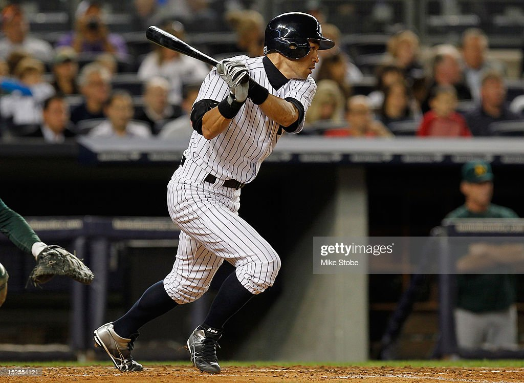 <a gi-track='captionPersonalityLinkClicked' href=/galleries/search?phrase=Ichiro+Suzuki&family=editorial&specificpeople=201556 ng-click='$event.stopPropagation()'>Ichiro Suzuki</a> #31 of the New York Yankees hits an infield single in the third inning against the Oakland Athletics at Yankee Stadium on September 21, 2012 in the Bronx borough of New York City.