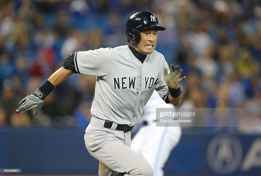 <a gi-track='captionPersonalityLinkClicked' href=/galleries/search?phrase=Ichiro+Suzuki&family=editorial&specificpeople=201556 ng-click='$event.stopPropagation()'>Ichiro Suzuki</a> #31 of the New York Yankees hits an infield single in the ninth inning during MLB game action against the Toronto Blue Jays on April 4, 2014 at Rogers Centre in Toronto, Ontario, Canada.