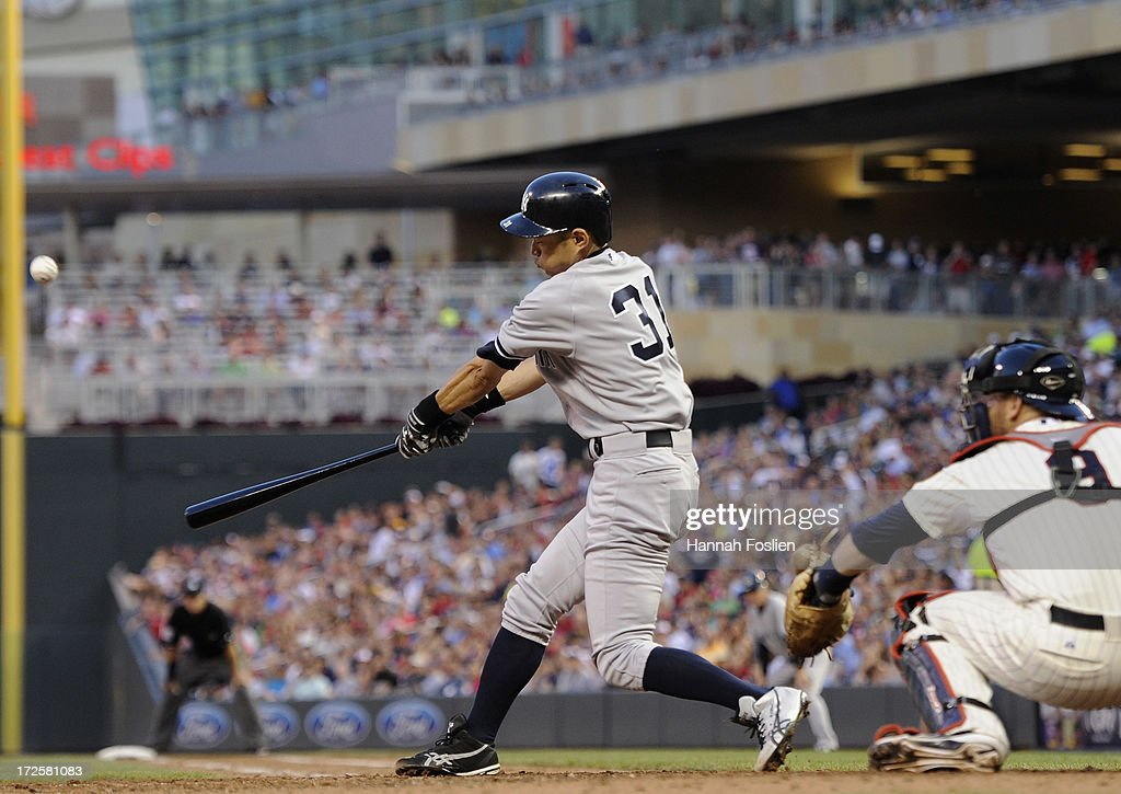 Ichiro Suzuki #31 of the New York Yankees hits double as Ryan Doumit #9 of the Minnesota Twins catches during the sixth inning of the game on July 3, 2013 at Target Field in Minneapolis, Minnesota.