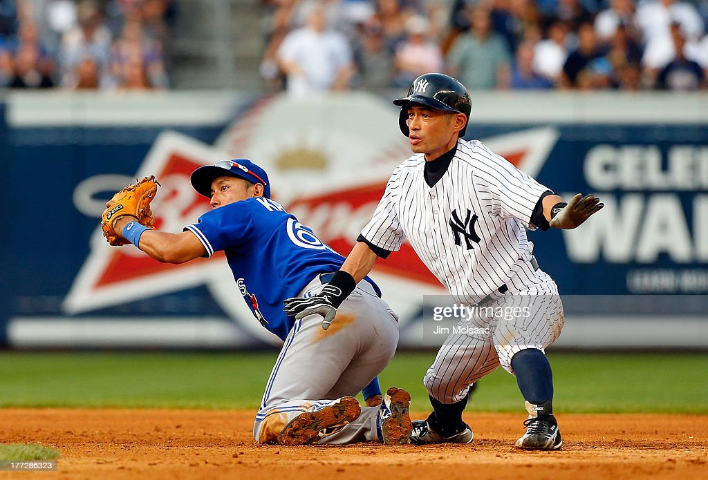 <a gi-track='captionPersonalityLinkClicked' href=/galleries/search?phrase=Ichiro+Suzuki&family=editorial&specificpeople=201556 ng-click='$event.stopPropagation()'>Ichiro Suzuki</a> #31 of the New York Yankees in action against <a gi-track='captionPersonalityLinkClicked' href=/galleries/search?phrase=Munenori+Kawasaki&family=editorial&specificpeople=690355 ng-click='$event.stopPropagation()'>Munenori Kawasaki</a> #66 of the Toronto Blue Jays at Yankee Stadium on August 22, 2013 in the Bronx borough of New York City. The Yankees defeated the Blue Jays 5-3.