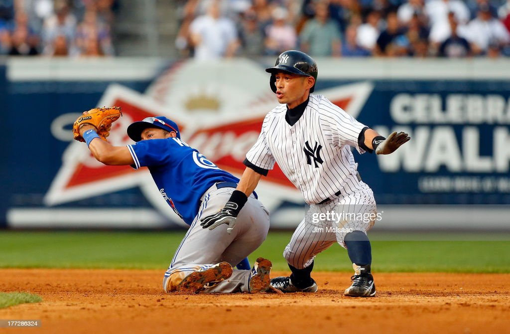 Ichiro Suzuki #31 of the New York Yankees in action against Munenori Kawasaki #66 of the Toronto Blue Jays at Yankee Stadium on August 22, 2013 in the Bronx borough of New York City. The Yankees defeated the Blue Jays 5-3.