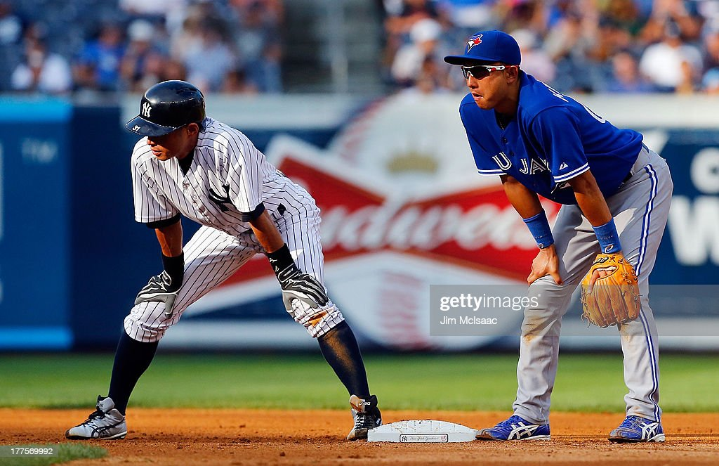 Ichiro Suzuki #31 of the New York Yankees in action against Munenori Kawasaki #66 of the Toronto Blue Jays at Yankee Stadium on August 22, 2013 in the Bronx borough of New York City. The Yankees defeated the Blue Jays 5-3.