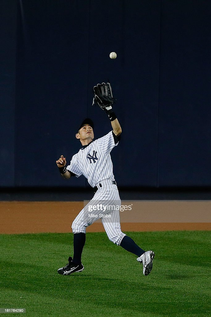 <a gi-track='captionPersonalityLinkClicked' href=/galleries/search?phrase=Ichiro+Suzuki&family=editorial&specificpeople=201556 ng-click='$event.stopPropagation()'>Ichiro Suzuki</a> #31 of the New York Yankees in action in the second inning against the Tampa Bay Rays at Yankee Stadium on September 24, 2013 in the Bronx borough of New York City. Rays defeated the Yankees 7-0.