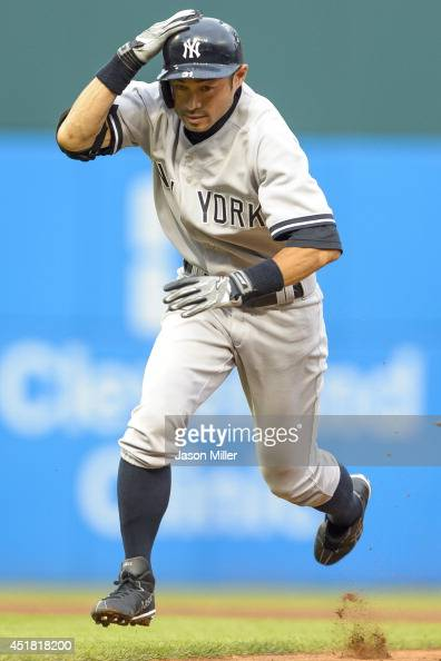 Ichiro Suzuki of the New York Yankees is caught in a rundown between first and second bases during the second inning against the Cleveland Indians at...