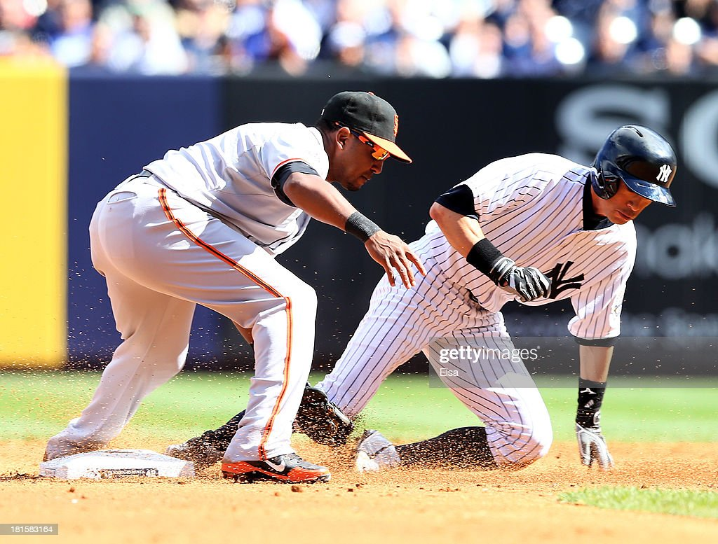 Ichiro Suzuki #31 of the New York Yankees is caught stealing second by Tony Abreu #10 of the San Francisco Giants during interleague play on September 22, 2013 at Yankee Stadium in the Bronx borough of New York City.