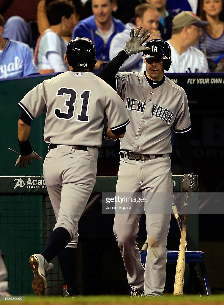 <a gi-track='captionPersonalityLinkClicked' href=/galleries/search?phrase=Ichiro+Suzuki&family=editorial&specificpeople=201556 ng-click='$event.stopPropagation()'>Ichiro Suzuki</a> #31 of the New York Yankees is congratulated by Chris Stewart #19 after scoring during the game against the Kansas City Royals at Kauffman Stadium on May 10, 2013 in Kansas City, Missouri.