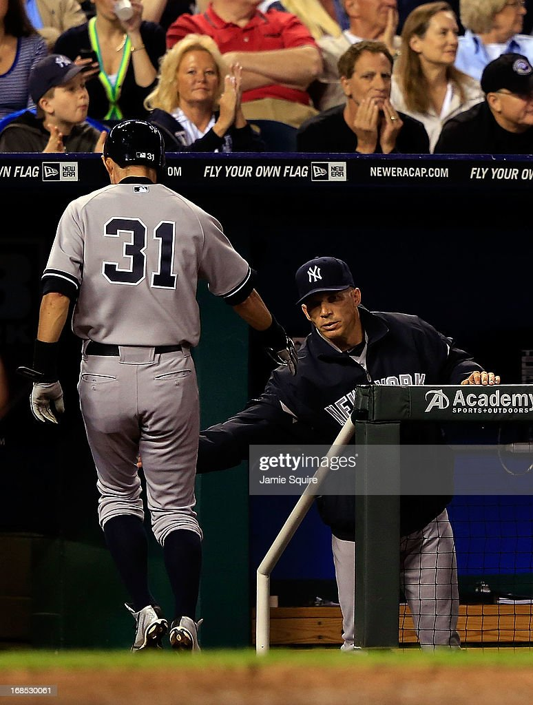 <a gi-track='captionPersonalityLinkClicked' href=/galleries/search?phrase=Ichiro+Suzuki&family=editorial&specificpeople=201556 ng-click='$event.stopPropagation()'>Ichiro Suzuki</a> #31 of the New York Yankees is congratulated by manager <a gi-track='captionPersonalityLinkClicked' href=/galleries/search?phrase=Joe+Girardi&family=editorial&specificpeople=208659 ng-click='$event.stopPropagation()'>Joe Girardi</a> #28 after scoring during the game against the Kansas City Royals at Kauffman Stadium on May 10, 2013 in Kansas City, Missouri.