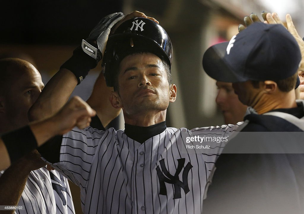 <a gi-track='captionPersonalityLinkClicked' href=/galleries/search?phrase=Ichiro+Suzuki&family=editorial&specificpeople=201556 ng-click='$event.stopPropagation()'>Ichiro Suzuki</a> #31 of the New York Yankees is congratulated by teammates after scoring on a squeeze bunt by Jacoby Ellsbury during the fifth inning against the Houston Astros in a MLB baseball game at Yankee Stadium on August 20, 2014 in the Bronx borough of New York City.