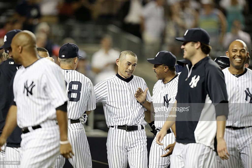 <a gi-track='captionPersonalityLinkClicked' href=/galleries/search?phrase=Ichiro+Suzuki&family=editorial&specificpeople=201556 ng-click='$event.stopPropagation()'>Ichiro Suzuki</a> #31 of the New York Yankees (C) is seen after connecting on a walk-off home run in the ninth inning with his teammates against the Texas Rangers at Yankee Stadium on June 25, 2013 in the Bronx borough of New York City.