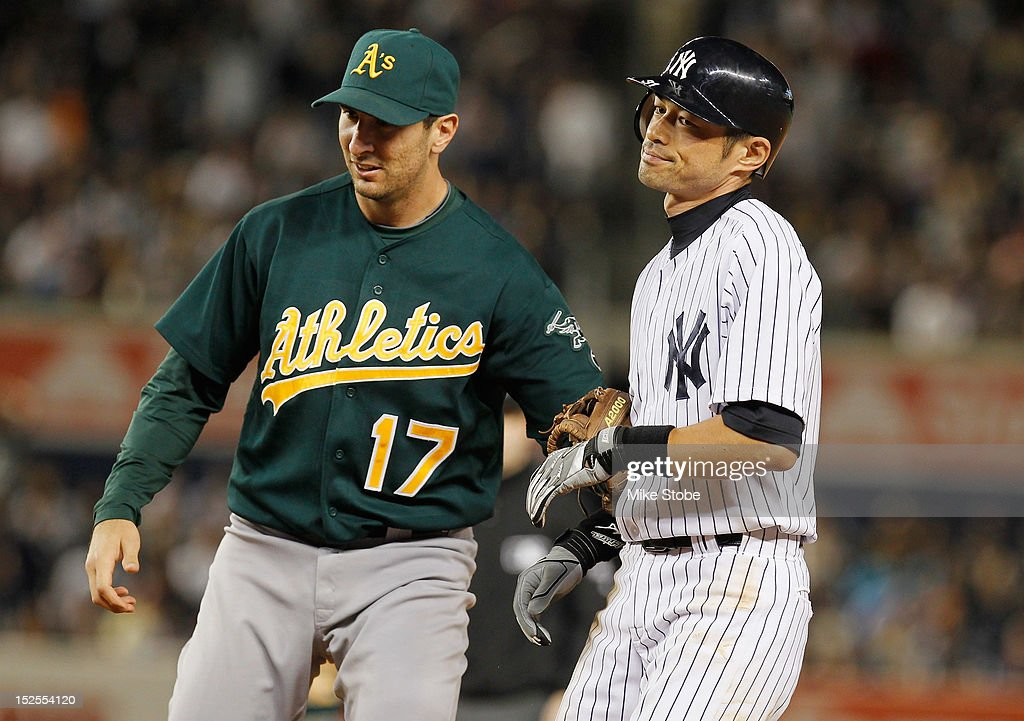 <a gi-track='captionPersonalityLinkClicked' href=/galleries/search?phrase=Ichiro+Suzuki&family=editorial&specificpeople=201556 ng-click='$event.stopPropagation()'>Ichiro Suzuki</a> #31 of the New York Yankees is tagged out by <a gi-track='captionPersonalityLinkClicked' href=/galleries/search?phrase=Adam+Rosales&family=editorial&specificpeople=4921731 ng-click='$event.stopPropagation()'>Adam Rosales</a> #17 of the Oakland Athletics after getting caught in a run down trying to stretch a single into a double in the fifth inning at Yankee Stadium on September 21, 2012 in the Bronx borough of New York City.