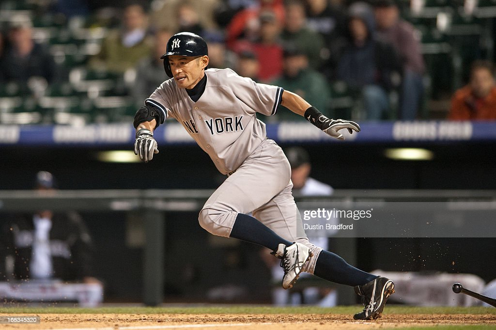 <a gi-track='captionPersonalityLinkClicked' href=/galleries/search?phrase=Ichiro+Suzuki&family=editorial&specificpeople=201556 ng-click='$event.stopPropagation()'>Ichiro Suzuki</a> #31 of the New York Yankees lays down a sacrifice bunt to move the runners at first and second base in the top of the ninth inning of a game against the Colorado Rockies at Coors Field on May 8, 2013 in Denver, Colorado. The Yankees beat the Rockies 3-2.