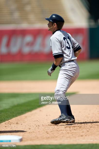 Ichiro Suzuki of the New York Yankees leads off first base against the Oakland Athletics during the fifth inning at Oco Coliseum on June 15 2014 in...