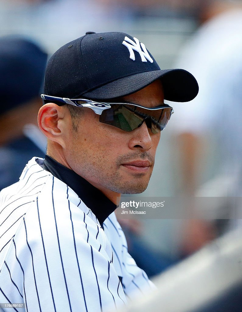 <a gi-track='captionPersonalityLinkClicked' href=/galleries/search?phrase=Ichiro+Suzuki&family=editorial&specificpeople=201556 ng-click='$event.stopPropagation()'>Ichiro Suzuki</a> #31 of the New York Yankees looks on from the dugout against the Los Angeles Angels of Anaheim at Yankee Stadium on August 15, 2013 in the Bronx borough of New York City. The Angels defeated the Yankees 8-4.