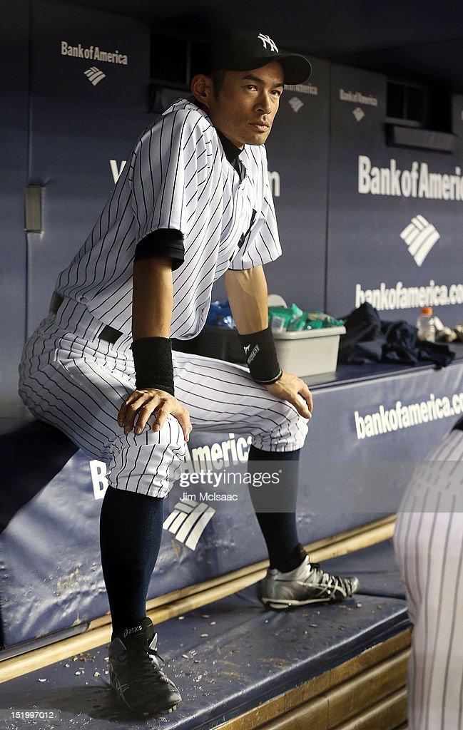 Ichiro Suzuki #31 of the New York Yankees looks on nfrom the dugout against the Tampa Bay Rays at Yankee Stadium on September 14, 2012 in the Bronx borough of New York City. Suzuki was not in the starting lineup.