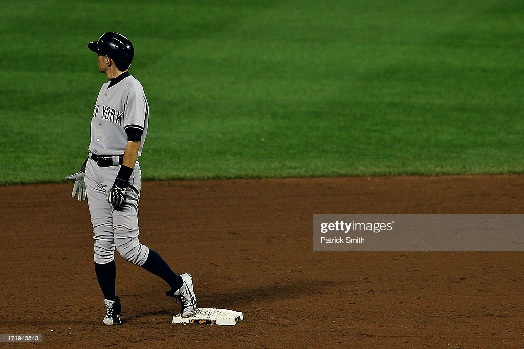 <a gi-track='captionPersonalityLinkClicked' href=/galleries/search?phrase=Ichiro+Suzuki&family=editorial&specificpeople=201556 ng-click='$event.stopPropagation()'>Ichiro Suzuki</a> #31 of the New York Yankees looks the scoreboard in the sixth inning against the Baltimore Orioles at Oriole Park at Camden Yards on June 29, 2013 in Baltimore, Maryland. The Baltimore Orioles won, 11-3.