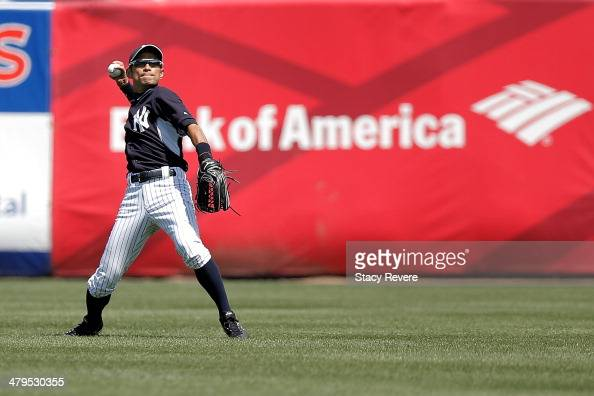 Ichiro Suzuki of the New York Yankees loosens up prior to the second inning of a game against the Boston Red Sox at George M Steinbrenner Field on...