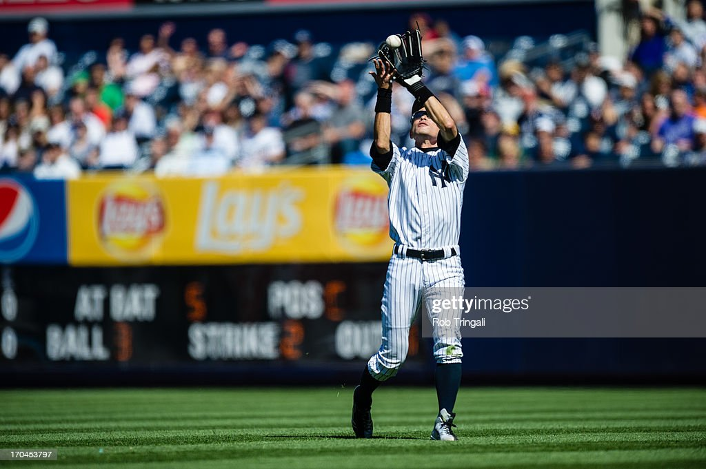 Ichiro Suzuki #31 of the New York Yankees makes a catch in the outfield during the game against the Oakland Athletics at Yankee Stadium on May 4, 2013 in the Bronx borough of Manhattan.