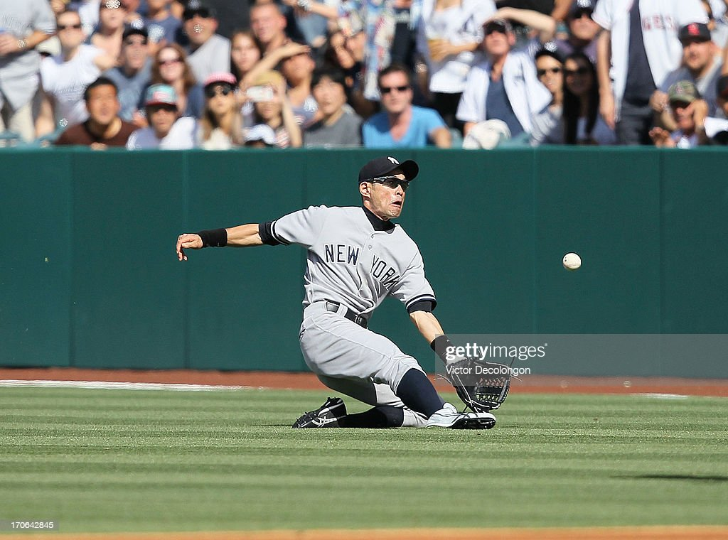 <a gi-track='captionPersonalityLinkClicked' href=/galleries/search?phrase=Ichiro+Suzuki&family=editorial&specificpeople=201556 ng-click='$event.stopPropagation()'>Ichiro Suzuki</a> #31 of the New York Yankees makes a sliding catch on a fly ball to right field in the first inning during the MLB game against the Los Angeles Angels of Anaheim at Angel Stadium of Anaheim on June 15, 2013 in Anaheim, California.