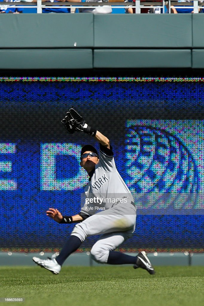 Ichiro Suzuki #31 of the New York Yankees makes the catch for the final out of the game against the Kansas City Royals in the 9th inning on May 12, 2013 at Kauffman Stadium in Kansas City, Missouri.
