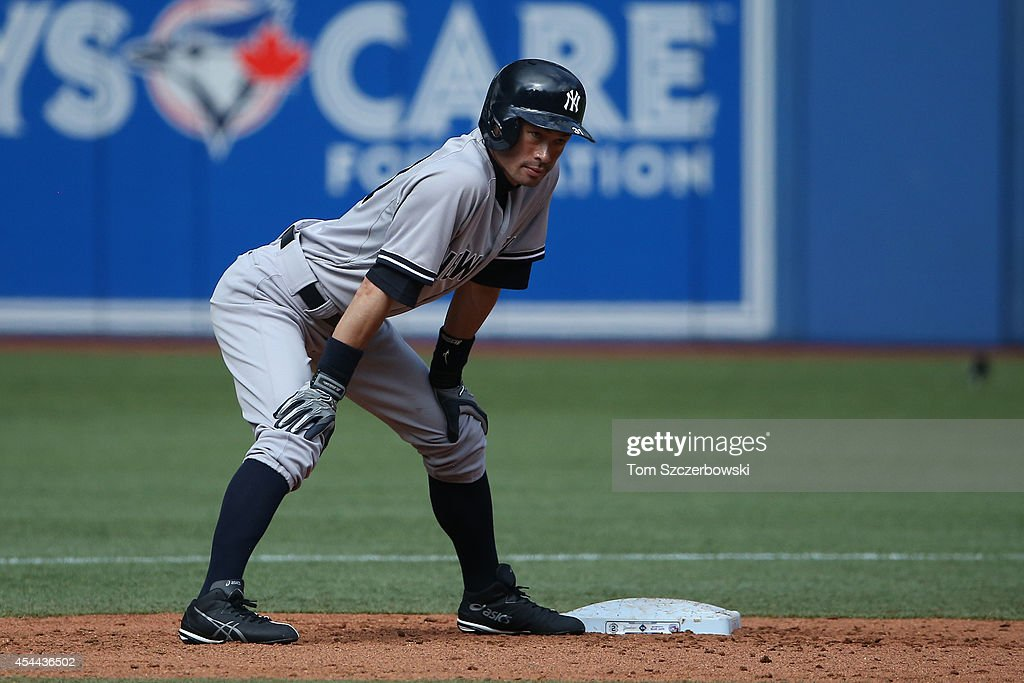 <a gi-track='captionPersonalityLinkClicked' href=/galleries/search?phrase=Ichiro+Suzuki&family=editorial&specificpeople=201556 ng-click='$event.stopPropagation()'>Ichiro Suzuki</a> #31 of the New York Yankees pinch runs for <a gi-track='captionPersonalityLinkClicked' href=/galleries/search?phrase=Jacoby+Ellsbury&family=editorial&specificpeople=4172583 ng-click='$event.stopPropagation()'>Jacoby Ellsbury</a> #22 at second base in the ninth inning during MLB game action against the Toronto Blue Jays on August 31, 2014 at Rogers Centre in Toronto, Ontario, Canada.