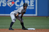 Ichiro Suzuki of the New York Yankees pinch runs for Jacoby Ellsbury at second base in the ninth inning during MLB game action against the Toronto...