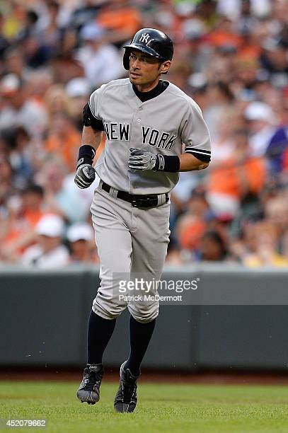 Ichiro Suzuki of the New York Yankees reacts after grounding out to first in the eighth inning during a game against the Baltimore Orioles at Oriole...