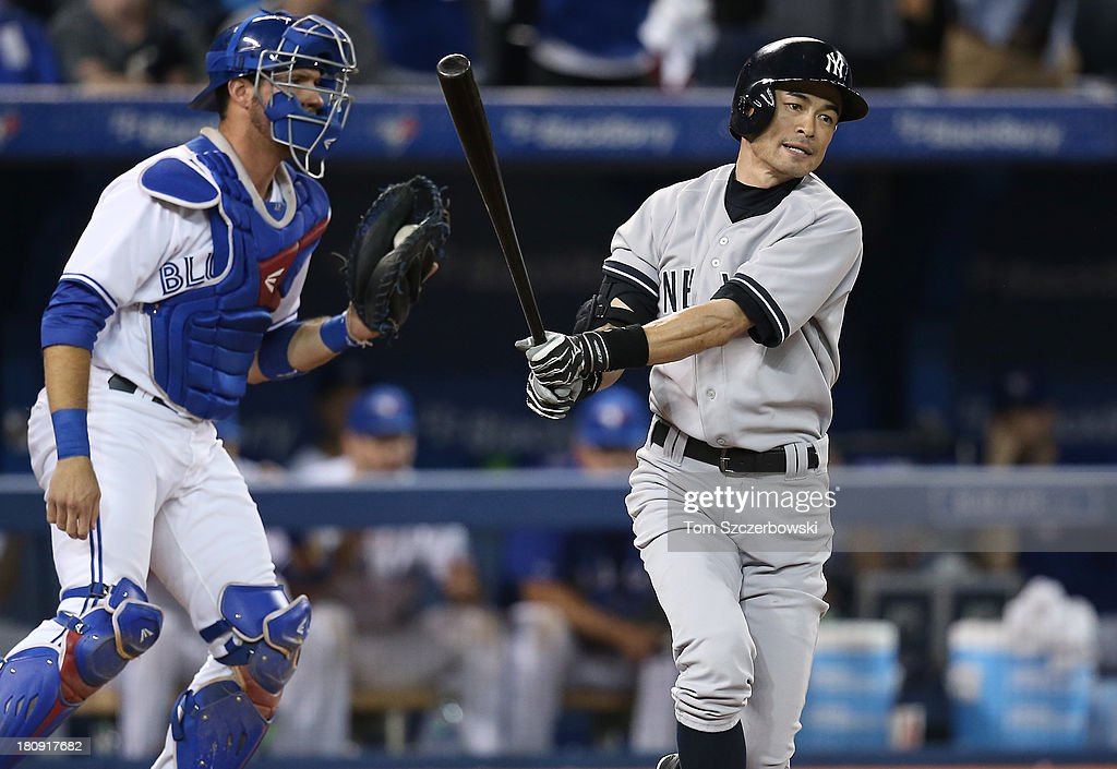 <a gi-track='captionPersonalityLinkClicked' href=/galleries/search?phrase=Ichiro+Suzuki&family=editorial&specificpeople=201556 ng-click='$event.stopPropagation()'>Ichiro Suzuki</a> #31 of the New York Yankees reacts after striking out in the ninth inning to end the game during MLB game action as <a gi-track='captionPersonalityLinkClicked' href=/galleries/search?phrase=J.P.+Arencibia&family=editorial&specificpeople=4959430 ng-click='$event.stopPropagation()'>J.P. Arencibia</a> #9 of the Toronto Blue Jays hangs on to the ball on September 17, 2013 at Rogers Centre in Toronto, Ontario, Canada.