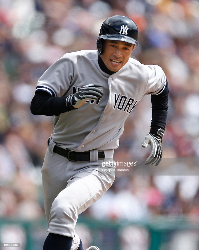 <a gi-track='captionPersonalityLinkClicked' href=/galleries/search?phrase=Ichiro+Suzuki&family=editorial&specificpeople=201556 ng-click='$event.stopPropagation()'>Ichiro Suzuki</a> #31 of the New York Yankees rounds third base on his way to scoring a third inning run against the Detroit Tigers at Comerica Park on April 7, 2013 in Detroit, Michigan.