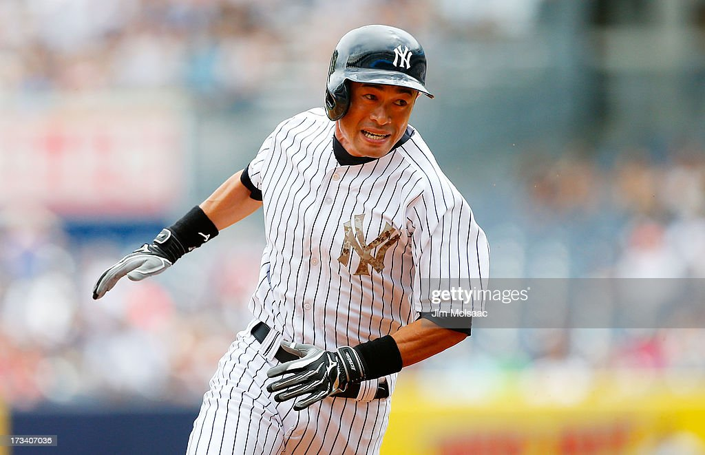 <a gi-track='captionPersonalityLinkClicked' href=/galleries/search?phrase=Ichiro+Suzuki&family=editorial&specificpeople=201556 ng-click='$event.stopPropagation()'>Ichiro Suzuki</a> #31 of the New York Yankees rounds third base to score a run in the first inning against the Minnesota Twins at Yankee Stadium on July 13, 2013 in the Bronx borough of New York City.