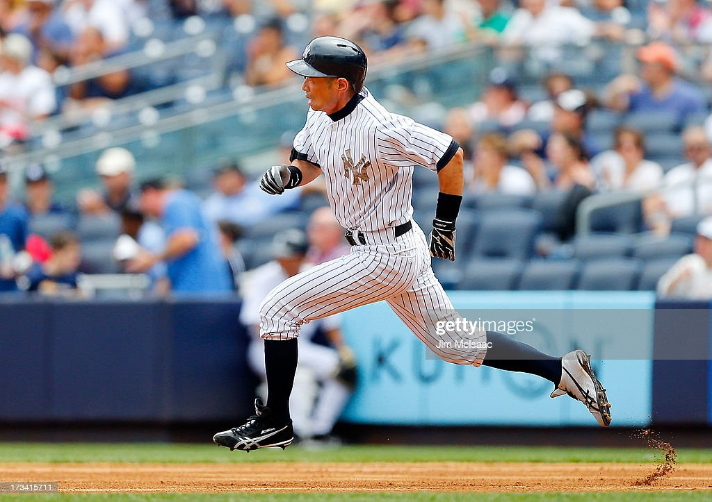 <a gi-track='captionPersonalityLinkClicked' href=/galleries/search?phrase=Ichiro+Suzuki&family=editorial&specificpeople=201556 ng-click='$event.stopPropagation()'>Ichiro Suzuki</a> #31 of the New York Yankees runs out a first inning double against the Minnesota Twins at Yankee Stadium on July 13, 2013 in the Bronx borough of New York City. The Twins defeated the Yankees 4-1.