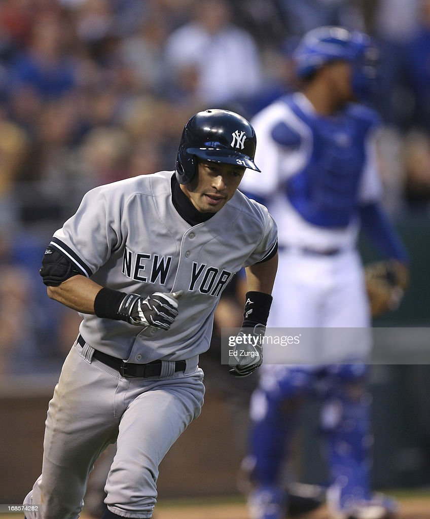 <a gi-track='captionPersonalityLinkClicked' href=/galleries/search?phrase=Ichiro+Suzuki&family=editorial&specificpeople=201556 ng-click='$event.stopPropagation()'>Ichiro Suzuki</a> #31 of the New York Yankees runs out a pop fly out in the eighth inning against the Kansas City Royals at Kauffman Stadium on May 11, 2013 in Kansas City, Missouri.