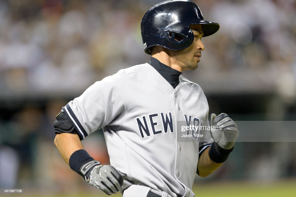<a gi-track='captionPersonalityLinkClicked' href=/galleries/search?phrase=Ichiro+Suzuki&family=editorial&specificpeople=201556 ng-click='$event.stopPropagation()'>Ichiro Suzuki</a> #31 of the New York Yankees runs out a single to right during the eighth inning against the Cleveland Indians at Progressive Field on July 10, 2014 in Cleveland, Ohio.