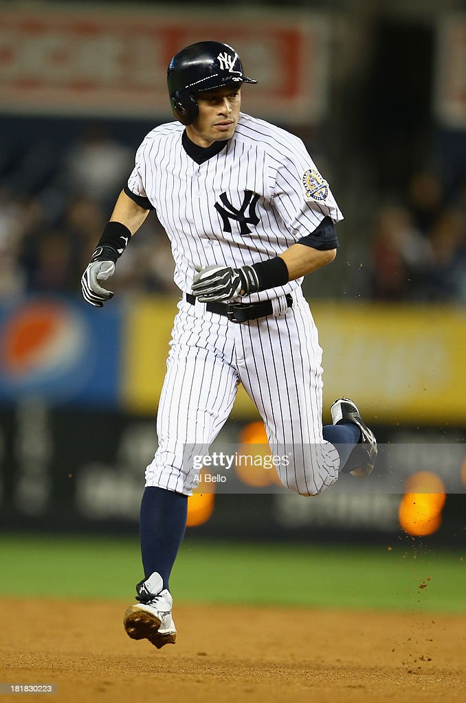 <a gi-track='captionPersonalityLinkClicked' href=/galleries/search?phrase=Ichiro+Suzuki&family=editorial&specificpeople=201556 ng-click='$event.stopPropagation()'>Ichiro Suzuki</a> #31 of the New York Yankees runs the bases against the Tampa Bay Rays during their game on September 25, 2013 at Yankee Stadium in the Bronx borough of New York City.
