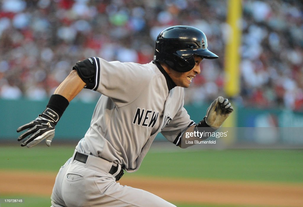 <a gi-track='captionPersonalityLinkClicked' href=/galleries/search?phrase=Ichiro+Suzuki&family=editorial&specificpeople=201556 ng-click='$event.stopPropagation()'>Ichiro Suzuki</a> #31 of the New York Yankees runs to first base after hitting a single in the seventh inning against the Los Angeles Angels of Anaheim at Angel Stadium of Anaheim on June 15, 2013 in Anaheim, California.