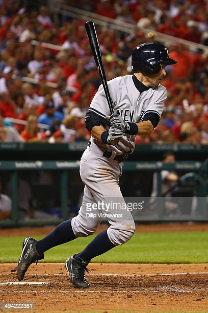 Ichiro Suzuki of the New York Yankees runs to first base after hitting into a ground out against the St Louis Cardinals in the seventh inning at...