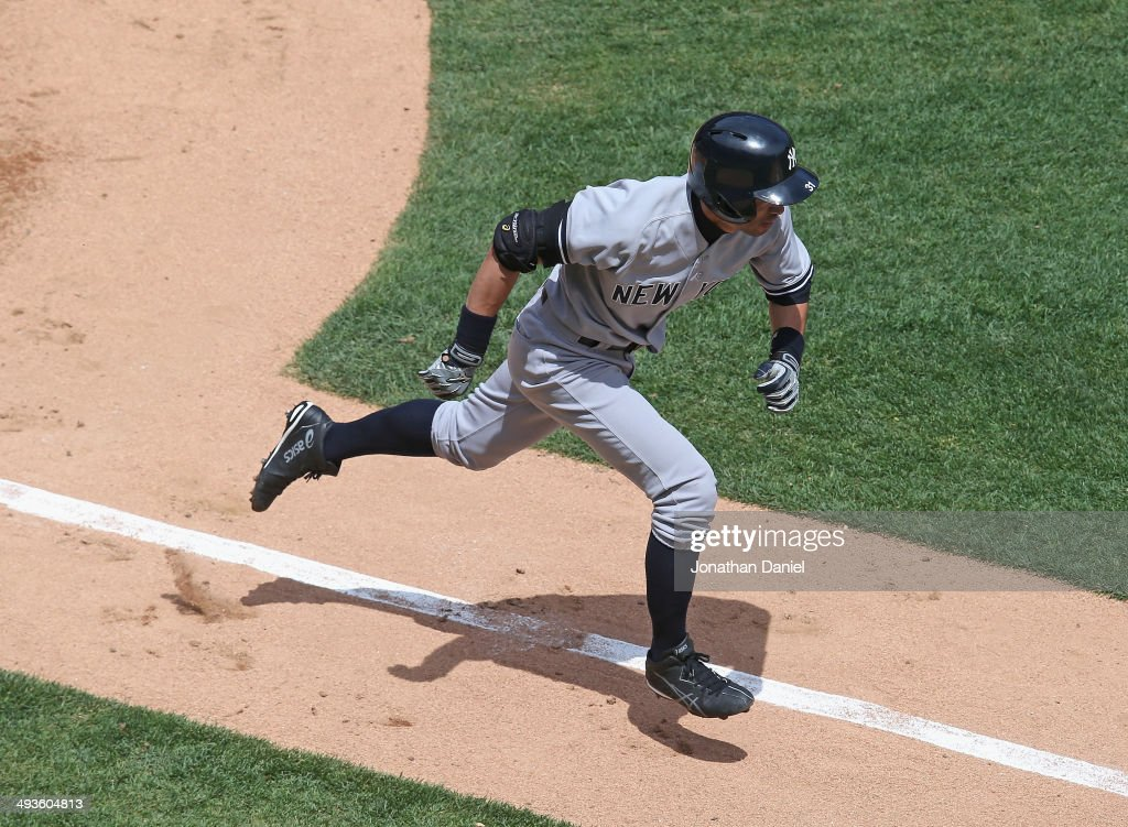 Ichiro Suzuki #31 of the New York Yankees runs to first base in the 3rd inning against the Chicago White Sox at U.S. Cellular Field on May 24, 2014 in Chicago, Illinois.