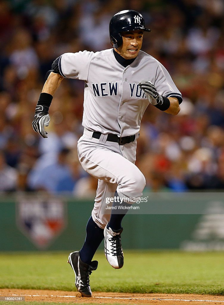 Ichiro Suzuki #31 of the New York Yankees runs to first base in the sixth inning against the Boston Red Sox during the game on September 13, 2013 at Fenway Park in Boston, Massachusetts.