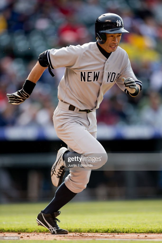 <a gi-track='captionPersonalityLinkClicked' href=/galleries/search?phrase=Ichiro+Suzuki&family=editorial&specificpeople=201556 ng-click='$event.stopPropagation()'>Ichiro Suzuki</a> #31 of the New York Yankees runs to first base on a ground out against the Colorado Rockies at Coors Field on May 9, 2013 in Denver, Colorado. The Yankees defeated the Rockies 3-1 to win the series.