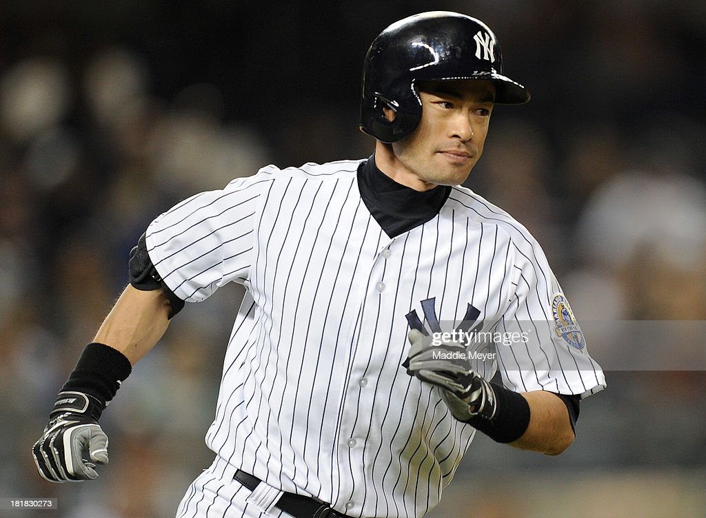 Ichiro Suzuki #31 of the New York Yankees runs towards first after hitting a single in the eighth inning against the Tampa Bay Rays on September 25, 2013 at Yankee Stadium in the Bronx borough of New York City.