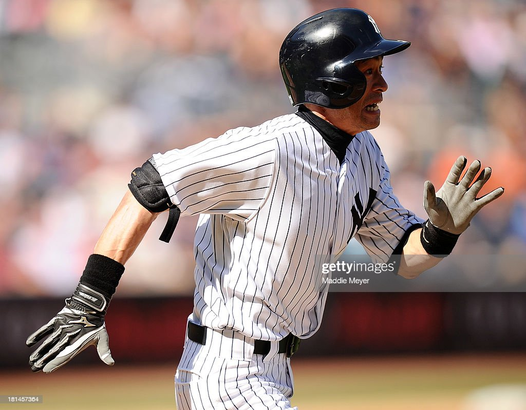 <a gi-track='captionPersonalityLinkClicked' href=/galleries/search?phrase=Ichiro+Suzuki&family=editorial&specificpeople=201556 ng-click='$event.stopPropagation()'>Ichiro Suzuki</a> #31 of the New York Yankees runs towards first during the fifth inning against the San Francisco Giants during interleague play on September 21, 2013 at Yankee Stadium in the Bronx borough of New York City.