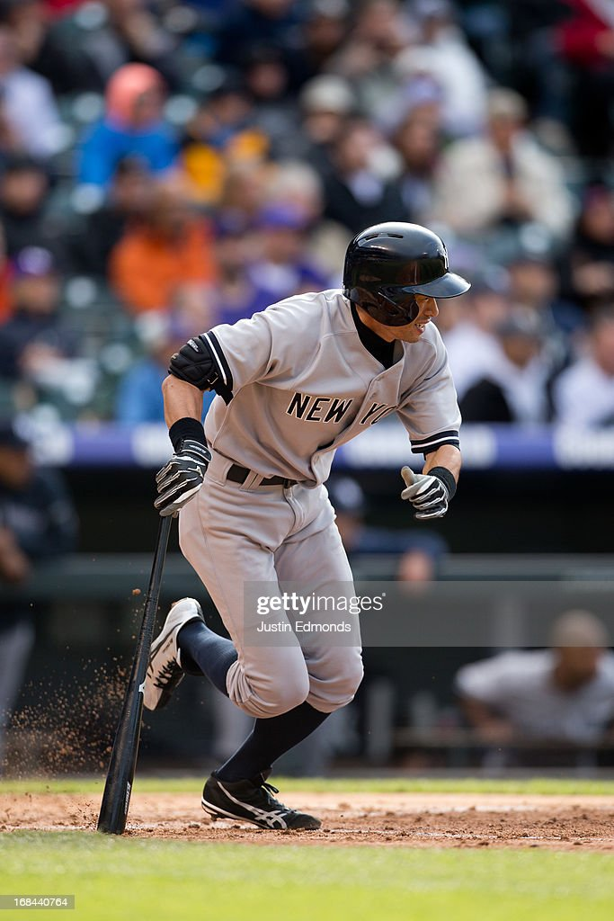 <a gi-track='captionPersonalityLinkClicked' href=/galleries/search?phrase=Ichiro+Suzuki&family=editorial&specificpeople=201556 ng-click='$event.stopPropagation()'>Ichiro Suzuki</a> #31 of the New York Yankees runs up the first base line on his way to grounding out against the Colorado Rockies at Coors Field on May 9, 2013 in Denver, Colorado. The Yankees defeated the Rockies 3-1 to win the series.
