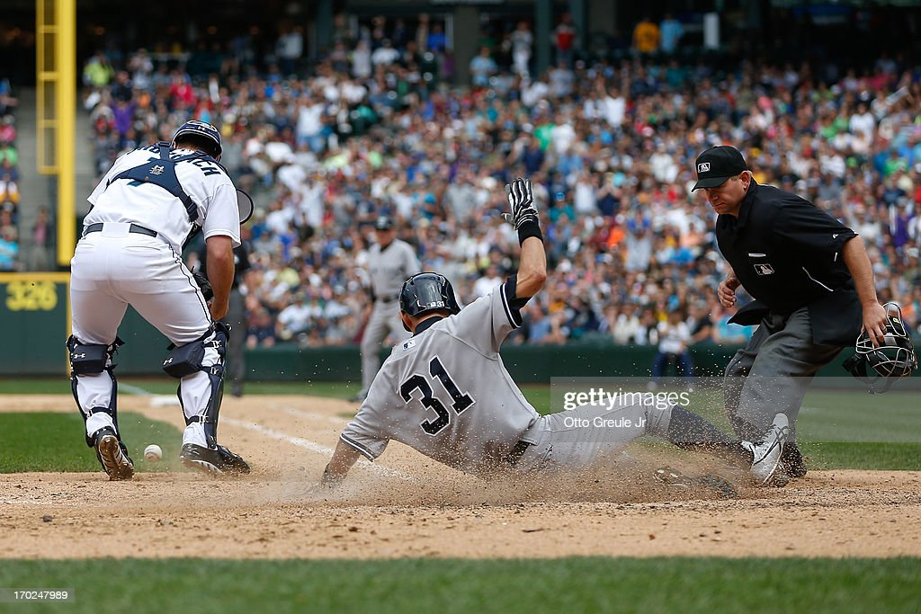 <a gi-track='captionPersonalityLinkClicked' href=/galleries/search?phrase=Ichiro+Suzuki&family=editorial&specificpeople=201556 ng-click='$event.stopPropagation()'>Ichiro Suzuki</a> #31 of the New York Yankees scores on an RBI single by Chris Stewart in the ninth inning against catcher Kelly Shoppach #7 of the Seattle Mariners at Safeco Field on June 9, 2013 in Seattle, Washington.